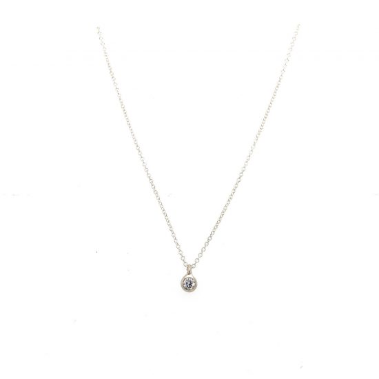 Just a Diamond Necklace with a 12 point diamond set in a matte finishe bezel.