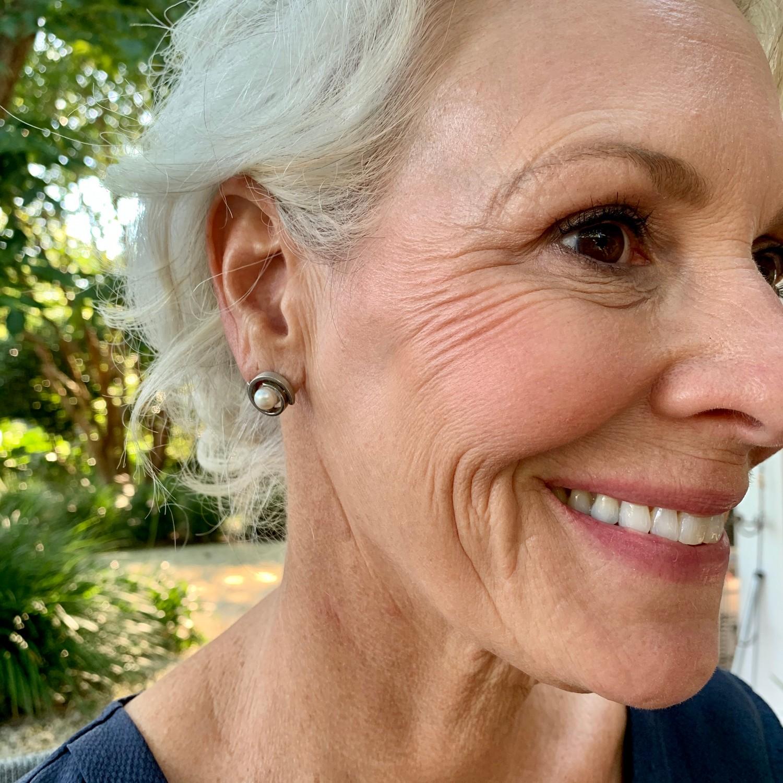double sterling pearl stud earrings on model